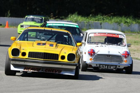 Just one example of a typical Vintage racing battle - Camaro (Dennis Repel) versu Mini (Geoff Tupholme) - that you can expect to see repeated at the 2016 BCHMR. - Brent Martin photo
