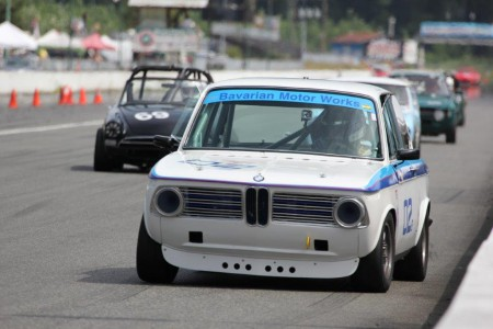 Ian Thomas leads a pack into Mission Raceway's Turn 1 in his 1971 BMW 2002 during the 2015 BCHMR - Brent Martin photo