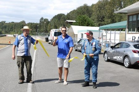 Kirk McLean cuts the ribbon to officially open the 2016 BCHMR. Canadian Motorsport Hall of Famer Bill Sadler (L) and BC road racing legend All Ores (R) 'pick up the pieces! - Brent Martin photo