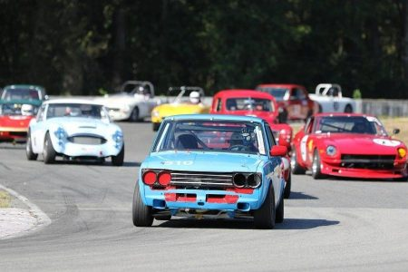 VRCBC Vice President Paul Haym leads a snarling horde of Vintage Closed Wheel Group A cars in his Datsun 510. - Brent Martin photo