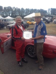 Charly Mitchel receives the SOVREN Canada Cup from Canadian motorsport legend and Hall of Famer, Bill Sadler. - VRCBC photo