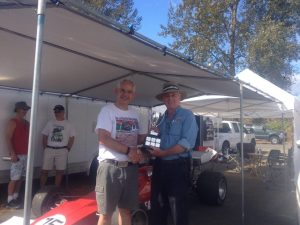 Collin Jackson receives the Chairman's Trophy from BCHMR Chairman and VRCBC President, Stanton Guy. - VRCBC photo