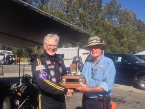 Paul Higgins receives the Abbotsford Trophy from VRCBC President Stanton Guy - VRCBC photo