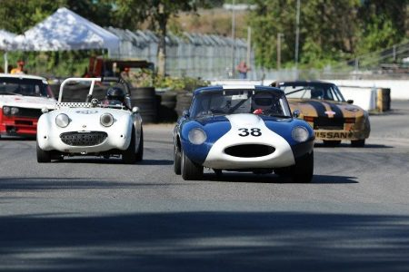 A classic British sports car 'David and Goliath' battle perfectly illustrates why Vintage racing is so much fun. Karlo Flores and his 1959 Austin Healey 'Bugeye' Sprite chase Gunter Pichler and his 1964 Jaguar XKE. - Brent Martin photo